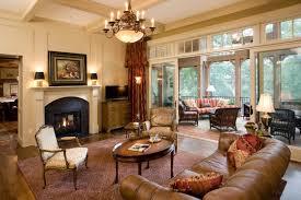 traditional living room white wall glass sliding doors white trim um toned wooden floors red rug
