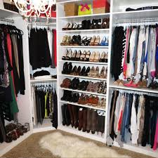 the abun of storage space that comes with with a walk in closet creates opportunities for creative storage solutions and organization