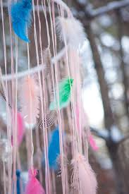 spray paint string or ribbon melissa used varying shades of pink and cream embroidery floss for this project lots of feathers scissors fishing line