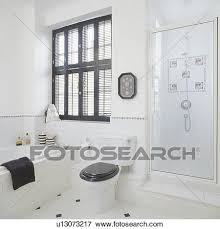 black plantation shutters.  Shutters Black Plantation Shutters Above Bath And Black Toilet Seat In Modern White  Bathroom With Glass Shower Door In Plantation Shutters