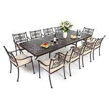 cast aluminium extending table with 10 brompton chairs autumn rust