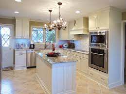 white kitchen cabinets with chandeliers