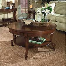magnussen aidan round tail table and end table set in cinnamon finish
