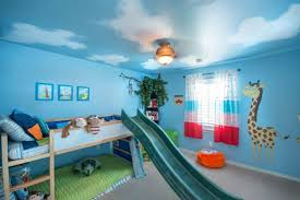 Blue Bedroom Ideas For Kids With Cute Ceiling Lighting And Giraffe Wallpaper