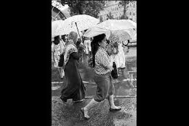 photo essay a moment of stillness slideshow livemint women walking towards the chhatrapati shivaji terminus in mumbai the umbrella patterns fascinated the photographer