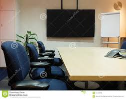 room ergonomic furniture chairs: the empty meeting room with used office furniture conference table fabric ergonomic chairs