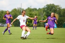 Elon Womens Soccer Player Angela Funari Evades A Tackle