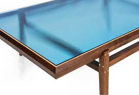 american pintor coffee table walnut frame with brass inlay blue glass top for