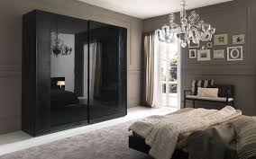 bedroom closet design. Bedroom: Fantastic White Chandelier Idea With Deluxe Glass Design And Lovable Black Closet Bedroom