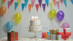 birthday cake burning candles wall decoration flags balloons stock