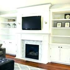 hanging tv above fireplace how