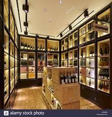 wine lighting. Selfridges Wine Shop, London, United Kingdom. Architect: Campaign Design, 2014. Champagne Display In Units With Shelf Lighting. Lighting Y