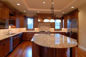 a kitchen with an island and granite counters
