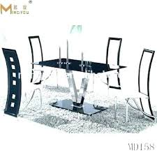 metal dining table with glass top elephant