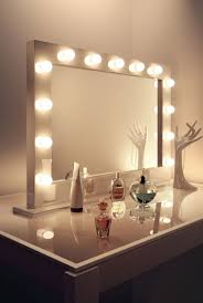 best lighting for makeup vanity. glass top wooden table and rectangle makeup mirror with lights as well best lighting for vanity