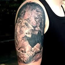 львы фото тату
