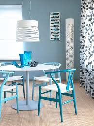 clic wishbone chairs in lovely blue steal the show in this small dining e design