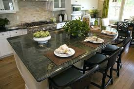 pale green kitchen cabinets with granite countertops and island decorating dark