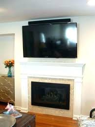 mounting tv over gas fireplace hanging over fireplace how high to hang above fireplace over fireplace mounting tv over gas fireplace