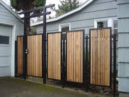 this project included two sections of fence paneling and two gates the main gate pictured