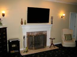 how to install mounting tv above fireplace for living room sconce lighting design with beige