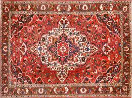 dark red blue and khaki are the main colours in mashhad carpets weavers in mashad use persian knots you should check the back of the carpet because the
