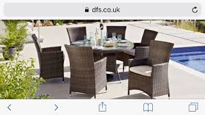 dfs six person outdoor patio dining table chairs parasol and coffee table rattan and glass tabletops