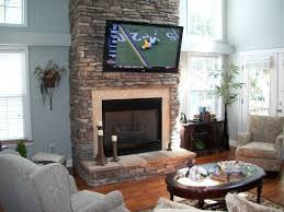 thrifty tv above on interior design ideas and stone fireplace surround in stacked stone fireplace