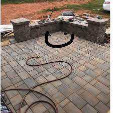 help with patio drainage at sitting wall