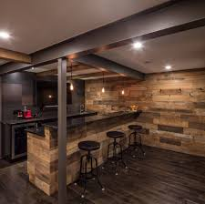Rustic Basement Bar With Steel Beams And Wood Wall