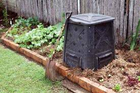 compost bin in raised bed garden