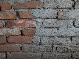 old brick wall with rough cement