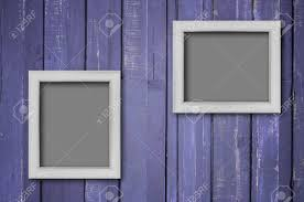 stock photo two white wood picture frame on purple color paint plank wall for background