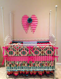 Teal and pink crib bedding. Beautiful bold colors and prints for a rustic  hacienda themed