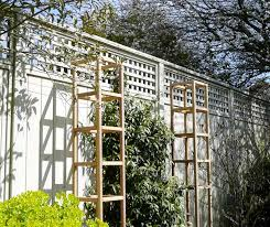 your garden with planters and obelisks