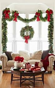 Classic Christmas Look. Garland around windows and doors is the new thing.