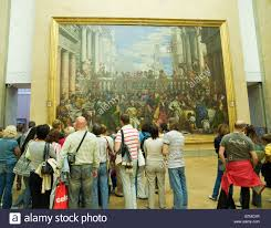 people looking at the wedding at cana, painted by italian The Wedding At Cana Painting By Paolo Veronese people looking at the wedding at cana, painted by italian renaissance artist paolo veronese in the louvre museum in paris france Paolo Veronese Inquisition