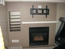 installing flat screen tv over fireplace amazing hanging your over the fireplace yea or nay driven