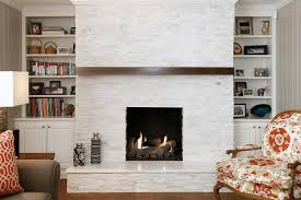 all white stacked stone fireplace
