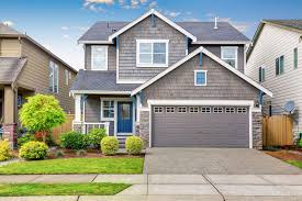 gray house with blue door and white window trim