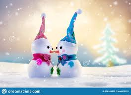 Toy Snowmen On A Bright Colorful Winter Background Two Are
