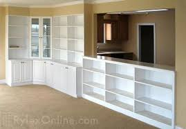white storage cabinet and open shelving