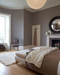 View in gallery Taupe meets red in a modern bedroom