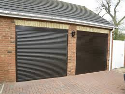 two car garage doorTwo Car Garage With Black Automatic Doors  Awesome Automatic