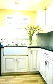 light above kitchen sink over lighting pendant