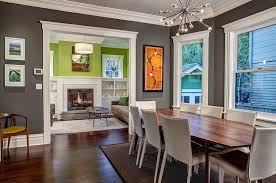 ... White trims bring added beauty to the gray dining room [Design: Board  and Vellum