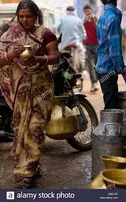 MIlkmand selling milk door to door at Bundi Stock Photo, Royalty ...
