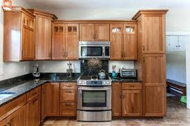 natural cherry cabinets mid sized elegant l shaped ceramic floor eat in kitchen photo in natural