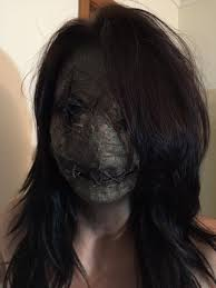 my friend did a trial run of the creepy voodoo doll make up