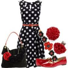 Fashion and stylish with black and white polka dot dress and red accessories